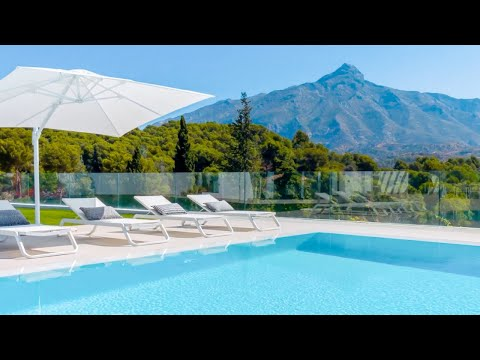 Touring an Ideal family vacation Home for sale   Frontline Golf   Nueva Andalucia, Spain