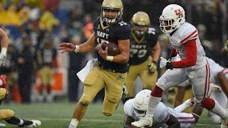 Annapolis, md. -- navy stunned no. 6 houston, romping to a 46-40 victory that seriously damaged the cougars' playoff hopes.will worth ran for 115 yards and t...