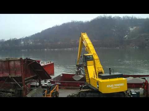 750 Komatsu with Norris Manufacturing Material Handler Unloading Barge