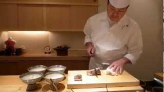 Yoshitake prepares grilled bonito at 3 Michelin Sushi Yoshitake in Tokyo