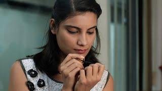Closeup of an Indian girl / model applying nail polish on her nails