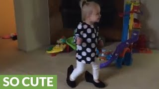 Little girl walks around in mommy's shoes