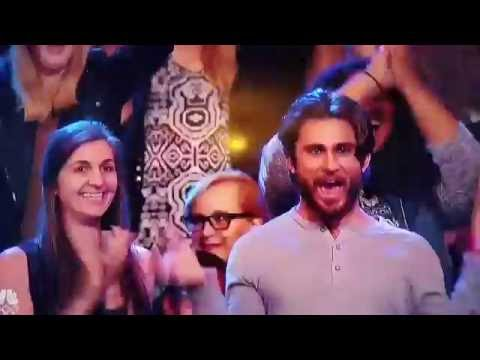 Guy swinging his hands in audience - Malevo Performance AGT