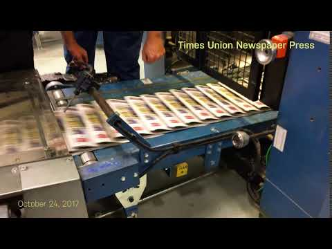 How to pick up a newspaper like a boss