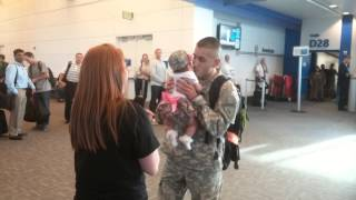 A soldier coming home from a 9 month deployment and meeting his daughter for the first time