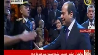 كلمات مؤثرة من طالب الشرطة عاطف وائل طاحون حول والده الشهيد.. والرئيس السيسي يصافح الأسرة