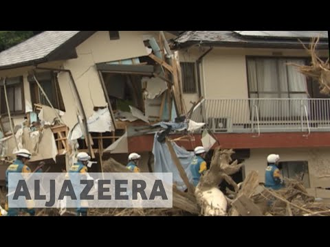 Japan floods: PM Shinzo Abe visits worst affected areas