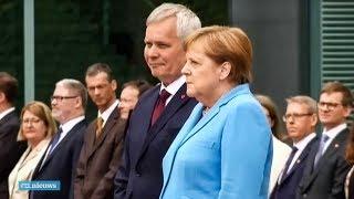 Angela Merkel voor de derde keer heftig trillend in het openbaar