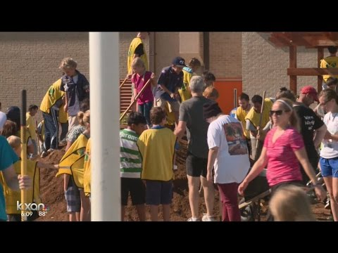 Community comes together to beautify Dobie Middle School