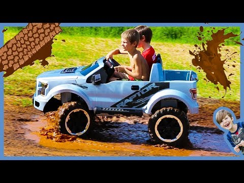Unboxing Ride on Cars For Kids - Power Wheels Ford F150 Raptor Truck Rides in the Mud!