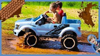 unboxing ride on cars for kids power wheels ford f150 raptor truck rides in the mud
