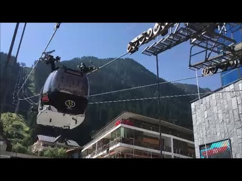 Austrian Cable Cars: Gliding Over the Alps to 'The Blue Danu