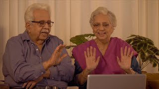 Shot of Indian old couple having video chat and waving hands to wish their son