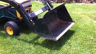 Yardman garden tractor with loader