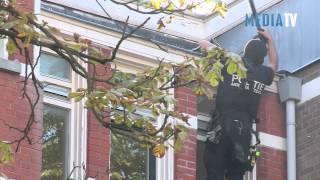Arrestatieteam haalt verwarde man uit woning Burgemeester Meineszlaan Rotterdam