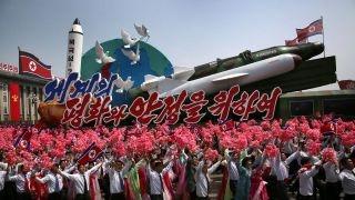 North Korea flaunts missiles in massive military parade