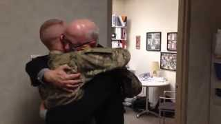 Dad breaks down when son returns home early from Afghanistan