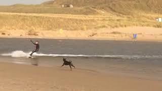 Chasing kite surfers