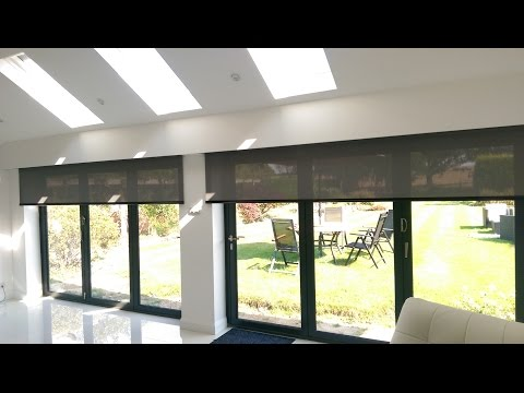 Electric roller blinds for byfold doors hidden behind a pelmet