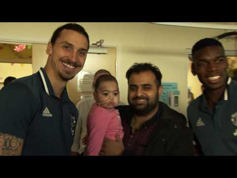 Manchester United players deliver Christmas gifts to local children's hospitals