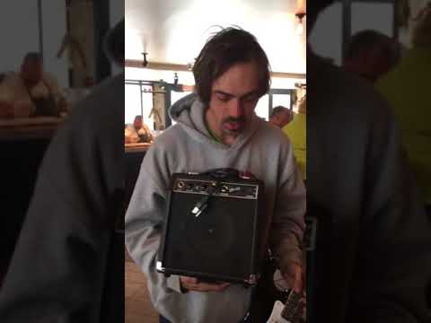 13 year old guitarist, Jason buys homeless musician guitar and amp to help him