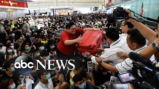 Hong Kong protests, the Iowa State Fair, Eid celebrations: World in Photos, Aug. 16