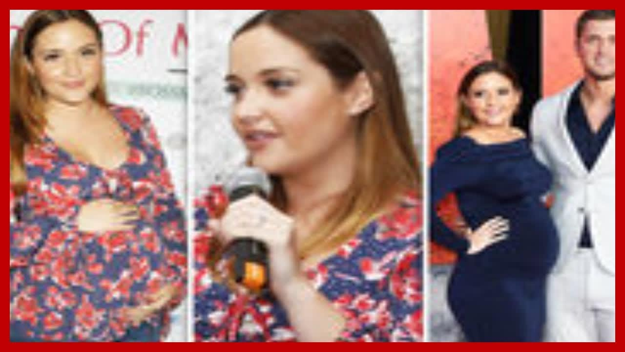 Jacqueline Jossa cradles baby bump and puts wedding ring back on