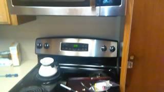GE microwave overhead stove bulbs socket broken off