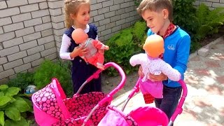 As a boy playing with a doll. BABY BORN AND Carriages for dolls. Children's channel grow with dreams