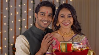 Indian husband-wife posing and smiling while looking into the camera - celebrating Karwa Chauth festival