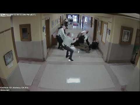 Surveillance video shows aggressive man punch courthouse sec