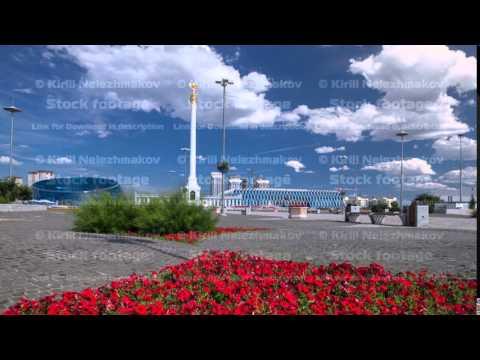 Stele monument Kazakh Eli with bird Samruk and Palace of Independence timelapse hyperlapse