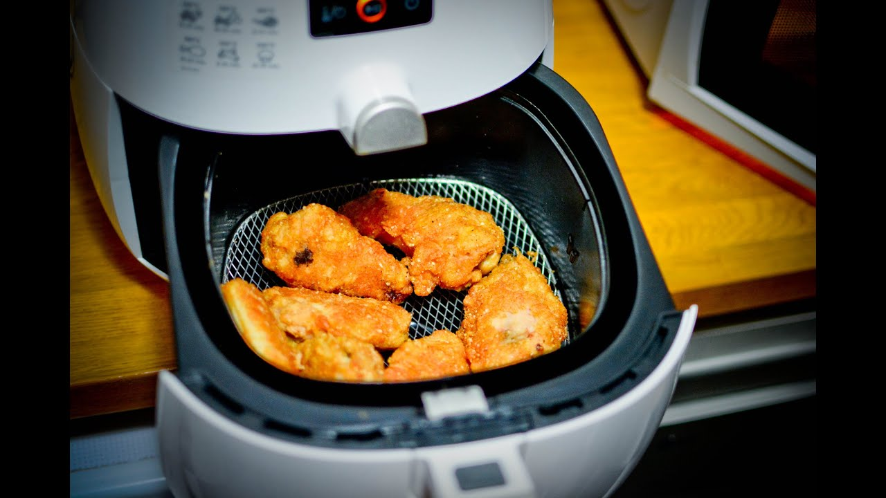Pollo frito freidora philips airfryer sin aceite for Cocinar wok sin aceite