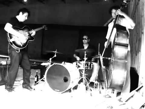 """Live performance by the Bill Longhorse Trio as part of the """"Resurrecting The Kessler"""" Series in Dallas, TX.  The audio portion is of poor quality, as it was not originally intended for publication.  (Upright Bass performed by Andrew Wilkins)"""