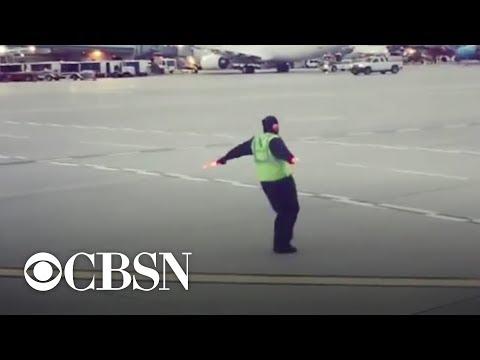 Airport employee caught dancing on tarmac