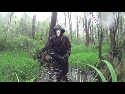 Gasmask, chestwaders, rain weather and mud pool