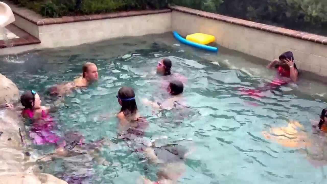 Mermaid Melissa in pool training school for kids to be real mer