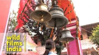 Hindu devotees ringing temple bells in Nainital