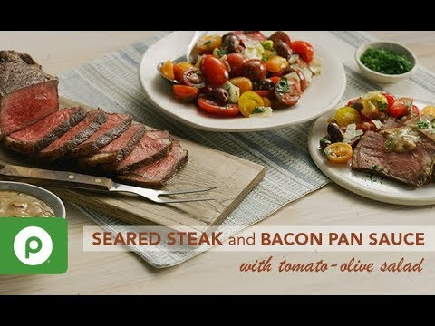 Seared Steak and Bacon Pan Sauce with Tomato-Olive Salad. A Publix Aprons recipe.