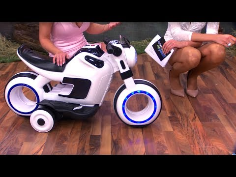 Playtastic Futuristic electric children's bike with LED light and MP3 player with Katie Steiner