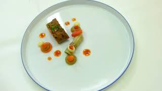 Chef Rolf Fliegauf prepares a regional lamb dish at 2 star restaurant Ecco Ascona Switzerland