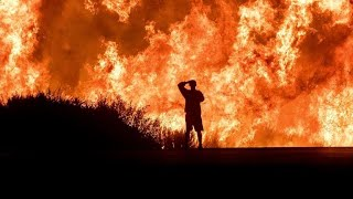 California fires: Crews race to contain flames with winds set to pick up