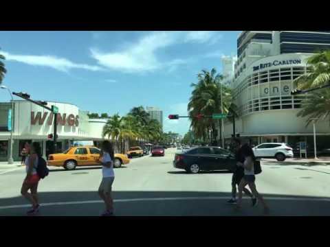 Driving Downtown Collins Avenue Miami Beach Florida USA