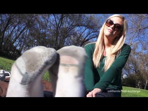 Woman takes off socks to show feet