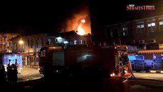 Massive blaze razes five Kota Baru shophouses