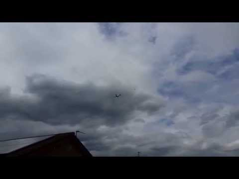 Danger above! Manchester bound plane escorted by jet fighter