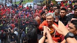Tempers flare at solidarity rally for Zahid