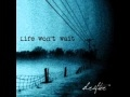 Download Life Won't Wait - Trapped MP3 song and Music Video