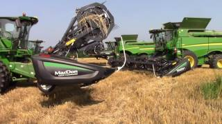 Video 8 John Deere S690 Combines Getting Ready to Cut Wheat download MP3, 3GP, MP4, WEBM, AVI, FLV November 2017
