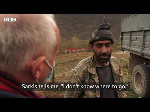 Armenian families burn down their own homes